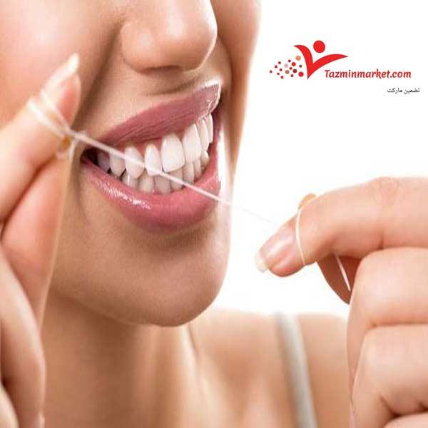 فواید کشیدن نخ دندان