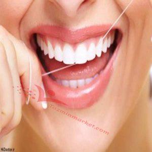 کشیدن صحیح نخ دندان